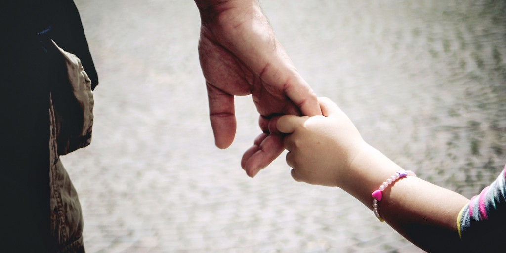 Hands: dad and daughter